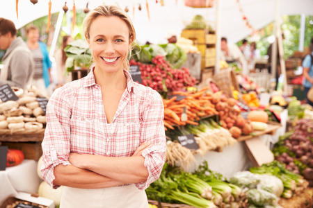 lifestyle woman: Female Stall Holder At Farmers Fresh Food Market