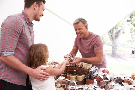 man nuts: Family Buying Nuts From Stall At Farmers Market Stock Photo