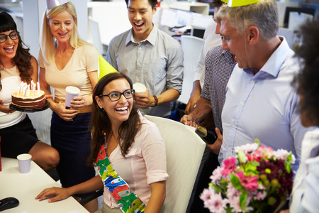happy workers: Celebrating a colleagues birthday in the office Stock Photo