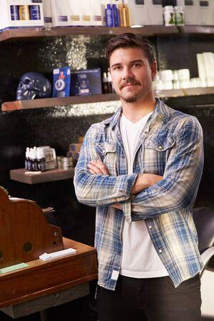 barber shops: Portrait Of Male Barber Standing By Cash Register