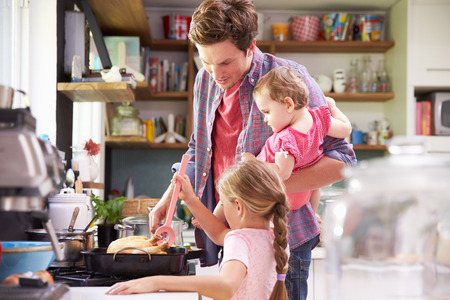 cook: Daughter Helping Father To Cook Meal In Kitchen