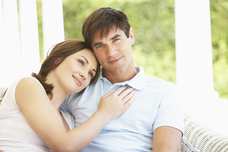 couple relaxing: Romantic Young Couple Relaxing Together On Outside Bench