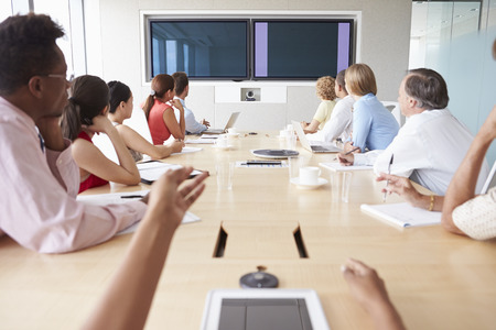 point of view: Point Of View Shot Of Businesspeople Around Boardroom Table Stock Photo