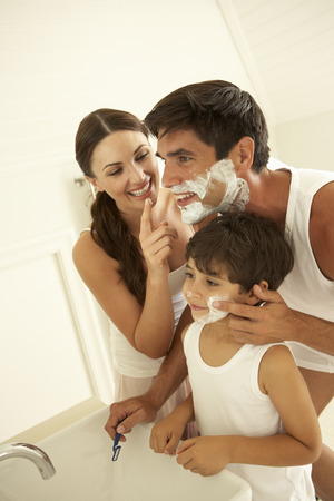 mom son: Mother And Son Watching Father Wet Shaving With Razor