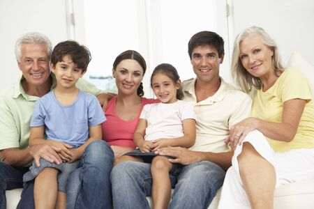 thirties portrait: Extended Family Relaxing On Sofa At Home Together