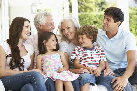 8 year old: Extendend family sitting in Garden