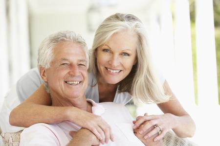 retired couple: Portrait Of Romantic Senior Couple Stock Photo
