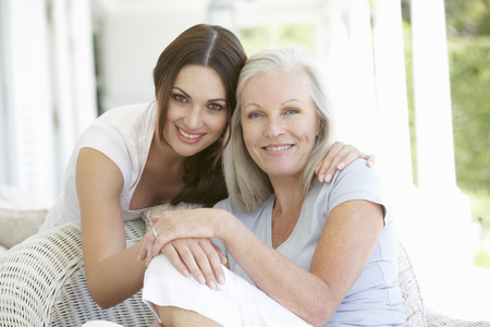 beautiful mother: Mature Mother And Daughter Hugging Stock Photo