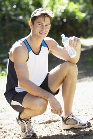 whilst: Man Drinking Bottled Water Whilst Jogging