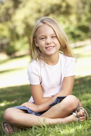 6 year old: Young Girl Relaxing In Park