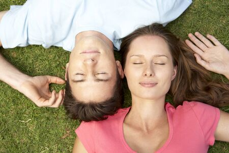 eyesclosed: Overhead Of Couple With EyesClosed Stock Photo