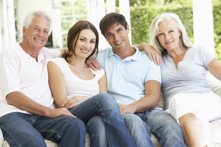 grown ups: Portrait Of Mature Parents Relaxing With Grown Up Children
