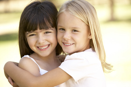 two year old: 2 Young Girls Giving Each Other Hug Stock Photo