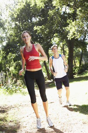 couple outdoor: Young Couple Running Through Woodland