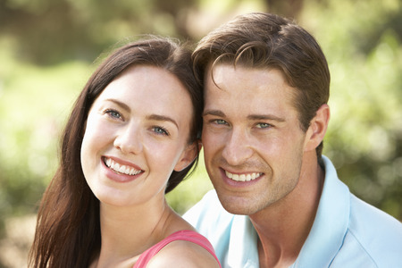 countryside loving: Portrait Of Young Couple Relaxing In Countryside