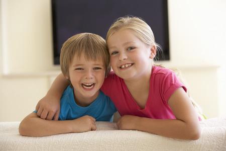 widescreen: Children Watching Widescreen TV At Home