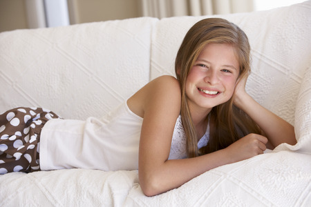 11 year old: Young Girl Relaxing On Sofa At Home