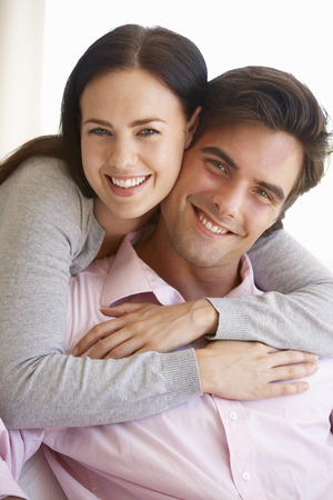 couple home: Young Couple Relaxing On Sofa Together At Home