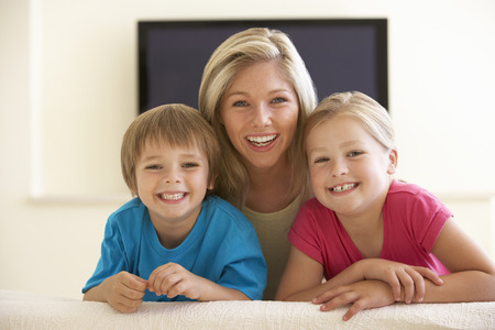 widescreen: Mother And Children Watching Widescreen TV At Home