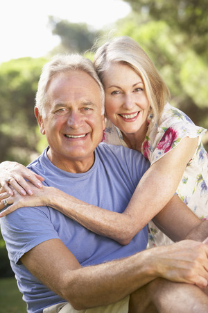 countryside loving: Portrait Of Senior Couple Relaxing In Countryside Stock Photo
