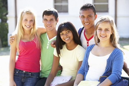 students group: Group Of Teenage Students Standing On campus Stock Photo