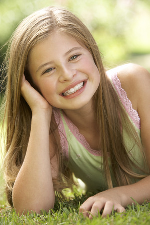 11 year old: Portrait Of Young Girl Relaxing In Countryside