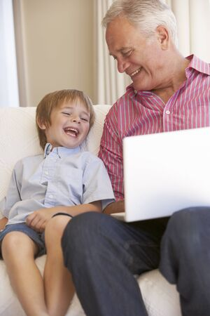 grandfather and grandson: Grandfather And Grandson Using Laptop At Home
