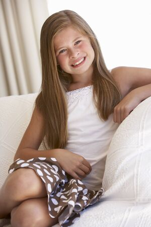 eleven: Young Girl Relaxing On Sofa At Home