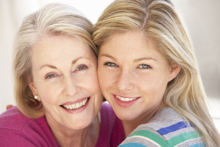 grown ups: Senior Woman Relaxing At Home With Adult Daughter
