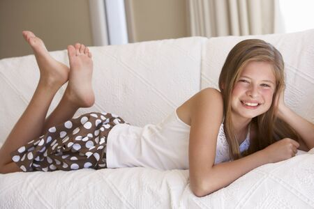 11 year old girl: Young Girl Relaxing On Sofa At Home