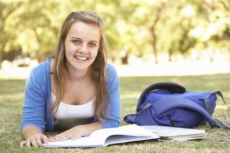 teenage girl: Teenage Girl Studying In Park