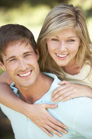 couple having fun: Young Couple Having Fun In Countryside Together