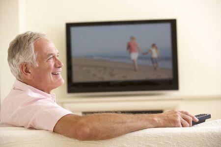 widescreen: Senior Man Watching Widescreen TV At Home