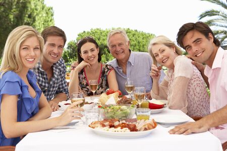 extended family: Extended Family Group Enjoying Outdoor Meal Together