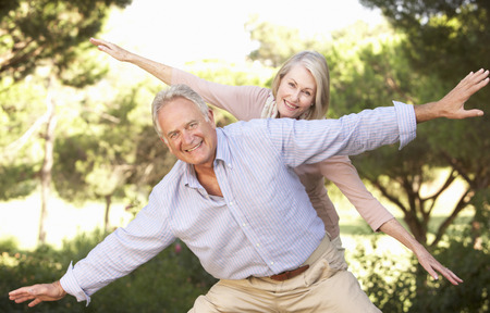 having fun: Portrait Of Senior Couple Having Fun In Countryside Stock Photo