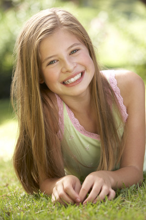 11 year old girl: Portrait Of Young Girl Relaxing In Countryside