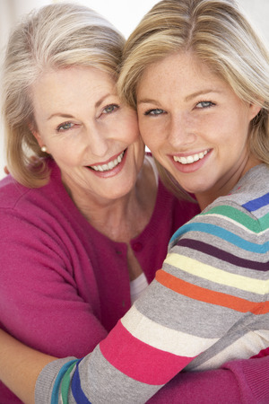 70s adult: Senior Woman Relaxing At Home With Adult Daughter