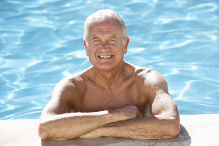 Senior Man Relaxing In Swimming Pool