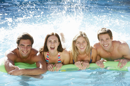 pool fun: Group Of Friends Relaxing In Swimming Pool Together