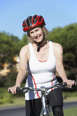 vertica: Senior Woman On Cycle Ride
