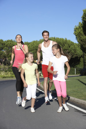jog: Young Family Running On Road