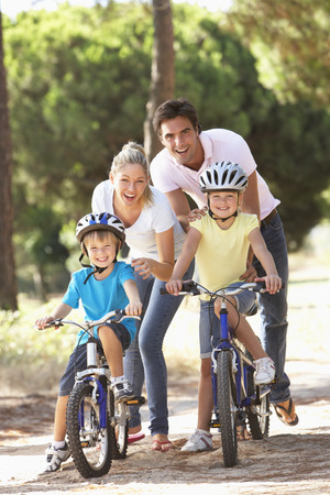 cycle ride: Family On Cycle Ride Together Stock Photo