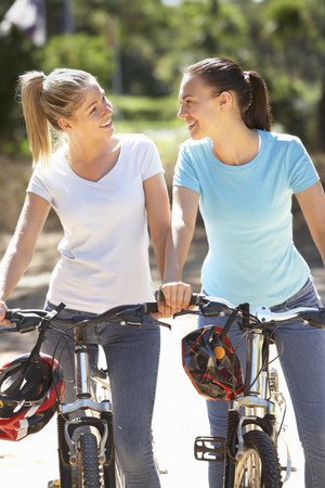 cycle ride: Two Young Women On Cycle Ride Together