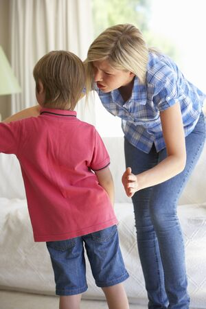 reprimanding: Mother Telling Off Son At Home
