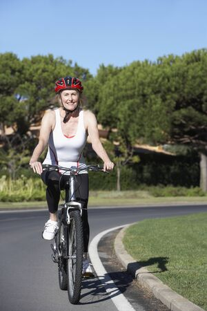 cycle ride: Senior Woman On Cycle Ride