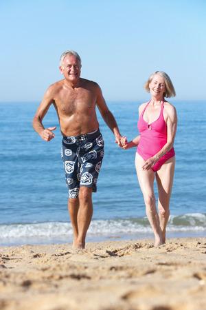 beach holiday: Senior Couple Enjoying Beach Holiday Stock Photo