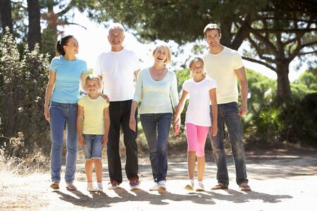 three generation: Three Generation Family On Summer Countryside Walk Together
