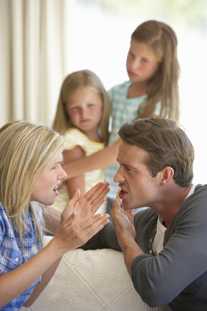 family fight: Parents Having Argument At Home In Front Of Children