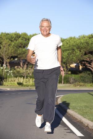 running man: Senior Man Running On Road