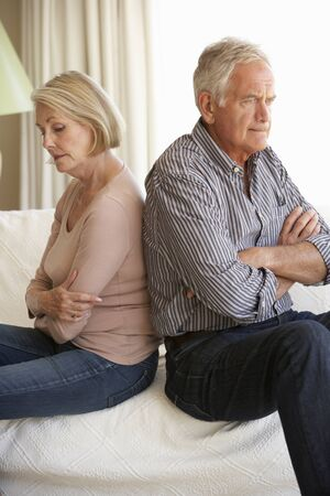 arguement: Senior Couple Having Argument At Home Stock Photo